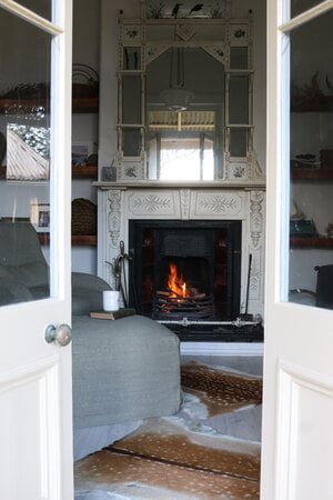 Original open fire place, ideal for staying cozy in winter
